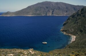 coastal view with boat and beach, tilos island